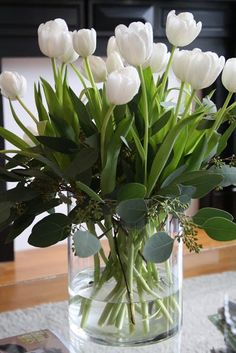 Fresh white Tulips and seeded Eucalyptus...simple and pretty