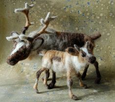 """This leggy needle felted Reindeer fawn 4"""" at his shoulder. He is made on a wire armature and can be posed almost anyway the real animal can move. He has tan and gray points and face with a white star and budding gray antlers.   Sara Renzulli"""