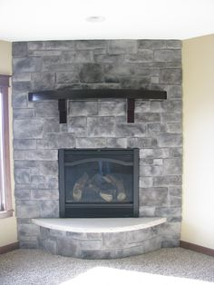 corner stone fireplace with raised arched hearth