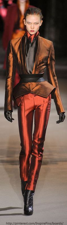 Haider Ackermann, The cut is fabulous and the color is shimmering bronze!  TG. But. that girl needs to eat a hamburger. And actually the camera adds 15lbs. I can only imagine how thin she looks in real life!