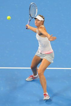 Maria Sharapova Photos: China Open: Day 5. Maria Sharapova of Russia plays a forehand in her match against Carla Suarez Navarro of Spain during day five of of the China Open at the National Tennis Center on October 1, 2014 in Beijing, China.