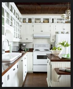 Terracotta floors, white cabinets, dyed concrete countertops.