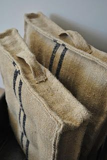 Sacking / hessian stuff - great texture & styling for the space! Perhaps too rough for couch cushion but maybe ok as floor cushion OR a large piece of this would make a FAB floor mat to define an area - perhaps to cozy-up the couch / lounge area.