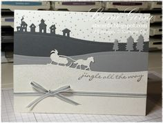 "Jingle All The Way, Sleigh Ride Edgelits, Iridescent Ice embossing powder, 1/8"" Silver Taffeta Ribbon (exterior)"