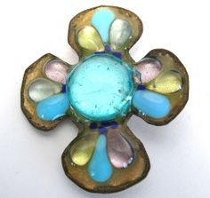 Similar to Bazot's work, California artist Ruth Buol created enamel jewelry in the 1950s and 1960s