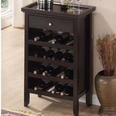 This elegant dark brown wood wine cabinet fits many wine bottles in a small space. Constructed of eco-friendly rubber wood and engineered wood, this functional wine storage cabinet has a convenient drawer and removable tray for your wine accessories. Wine Storage Cabinets, Wine Rack Cabinet, Wine Racks, Bar Cabinets, Kitchen Cabinets, Bar Furniture, Furniture Deals, Furniture Outlet, Kitchen Furniture