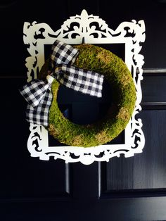 Walmart wreath: $5.47, Michael's frame 1/2 price: $5.00, 1/2 price ribbon at Hob Lob: $5.00 for the roll. White craft paint 99 cents. Hot glue it and go mama.