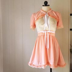 Beautiful chiffon babydoll suspender skirt with matching bed jacket. Ruffled lace trim and ribbon detailing.