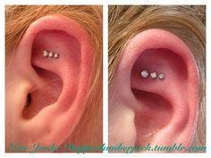 triple piercing above rook.