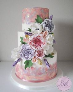 Pastel watercolour and sugar flowers wedding cake with gold leaf