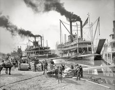 "The Mississippi River circa 1906. ""Steamboat landing at Vicksburg. Sternwheeler Belle of Calhoun and sidewheeler Belle of the Bends."""