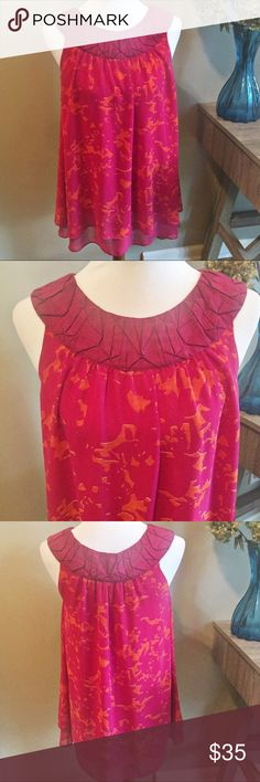 """CAbi Origami Sleeveless Top CAbi Origami Sleeveless Tunic Top in Excellent Condition. Fuchsia & Orange Patterned Print, beautiful origami neckline, light and airy. Approximate measurements laying flat: armpit to armpit 18"""", total length shoulder to hem 39"""". 👗👛👠👙👕Bundle & Save! CAbi Tops"""