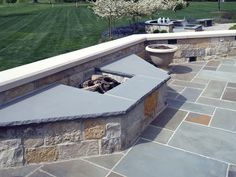Full Color Bluestone is used here for the paving, retaining wall, firepit and custom cut cap.