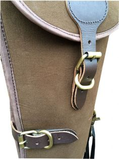 John Shooter Shootgun Slip - Canvas and Leather Manufactured from tough padded khaki canvas and leather this shot gun slip features a full length zip