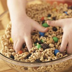 Morning Munchies - Recipe from Taste of Home:  Ingredients  1 package (18 ounces) granola without raisins  1 can (17 ounces) mixed nuts  1 package (15 ounces) raisins  1 package (14 ounces) milk chocolate M&M's  1 package (14 ounces) peanut M&M's  1 package (12-1/4 ounces) Honey-Nut Cheerios  1 package (8.9 ounces) Cheerios