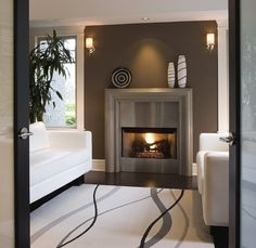 Contemporary fireplace surround ideas cast concrete mantel stainless steel modern home interior Modern Fireplace Mantles, Farmhouse Fireplace Mantels, Fireplace Tile Surround, Fireplace Wall, Living Room With Fireplace, Fireplace Surrounds, Concrete Fireplace, Fireplace Ideas, Victorian Fireplace