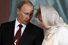 File photo of Putin and his wife Lyudmila talking during an Orthodox Easter service in the Christ the Saviour Cathedral in Moscow