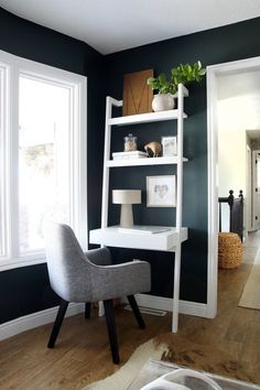 black wall living room with home office nook in corner of the room