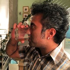 #saltandpepper #curlyhair #southindian #indian with #sideburns #drinking #oban #scotch wearing #plaid. A giant rock for an #earring. #Boston #cambma #profile #dressingup #fancy by rags350 January 23 2016 at 04:26AM