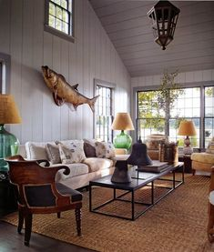 """BLUE HEAVEN  is designer Steven Gambrels Sag Harbor home. He refurbished this guest house to emulate a typical circa 1800's sag harbor """"half house"""". wide plank walls the furniture artfully placed and mixed perfectly with antiques, using his color palate of blue in ranges in the fabrics, prints and patterns  photo: eric plaseckl via:markdsikes.com"""