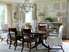 10 Common Interior Design Mistakes | Westchester County NY Home Decor | this is NOT one of the mistakes! Exquisite dining room with a grisaille mural, slip covered dining chairs, Mahogany dining table by James Michael Howard.