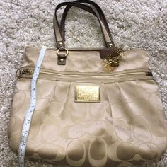 """Authentic COACH Authentic Coach Purse previously loved  with so many more years of love to give. A high end designer bag at a fantastic price. I have the matching wristlet posted in my closet. Please see photos and ask any questions before you purchase. 17"""" by 13"""" If you purchase this at the full price I will throw the matching wristlet in for $10! Thank you. Coach Bags Totes"""