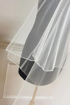 Shows a close up of a thread edge finish on a two tier veil and the quality of the veiling we use. Different lengths and widths catered for. Angel crystals can be added to add a bit of bling. All made in our studio in Fashion City, Dublin. online and in store sales available.