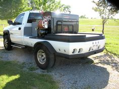This Dodge welding rig features a fully-contoured bed with matching body panels around the entire bed.