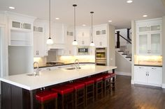 Cadence Homes-Love those red stools!