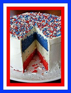 Red, White, and Blue Cheesecake with White Icing and Sprinkles