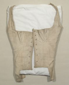 1800-1825, Corset bodice - Made from cream ribbed cotton tabby and lined with cream cotton. It fastens with 7 pairs of eyelet holes. (female)