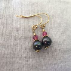 Hand crafted Pink Tourmaline faceted bead with a Black Sea Pear on Shepherds hook earring wires by MoonBeamsJewels on Etsy