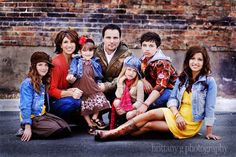 family of 7 pose.