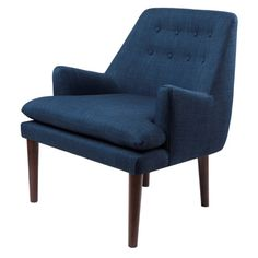 If transitional is your style, this button-tufted chair is the perfect choice. With a retro-inspired shape, this accent chair is made with a navy colored fabric and a wrap-around padded back.