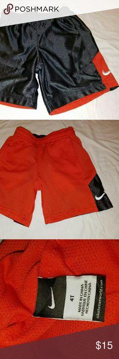 Nike shorts Grey and orange reversible shorts.  Orange side has pockets. In good condition. No trades/No holds. Nike Bottoms Shorts