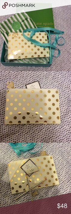 Kate Spade Pouch ♠️**new** Kate Spade gold polka dots pouch! Very cute can be used for anything. Pencil accessories included.  kate spade Bags Mini Bags