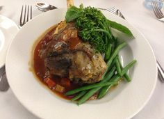 Presidents Dinner MAINS - Lamb Shanks with a leek potato mash, served with a rich tomato and red wine sauce and accompanied with green vegetables  www.gzrsl.com #thebunga #weddings #events #functions #food Lamb Shanks, Daily Specials, Wood Fired Pizza, Wine Sauce, Red Wine, Steak, Presidents, Potatoes, Events