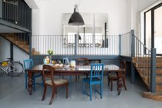Open plan industrial warehouse space. White walls. Mis-match chairs www.trunkcreative.co.uk