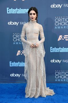 """LILY COLLINS DOES DRACULA'S DAUGHTER DRAG AT THE CRITICS' CHOICE AWARDS"" according to Tom & Lorenzo, who love this look of Lily Collins' in a Zuhair Murad couture gown."