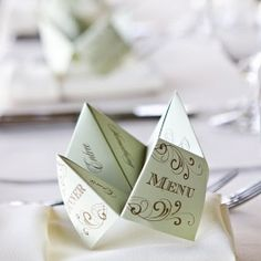 Remember the cootie catcher game you played in grade school? Add fun and nostalgia to your wedding by using a cootie catcher menu!
