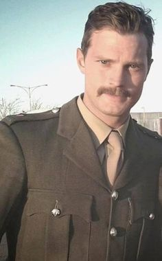 Jamie Dornan on set in uniform Swoon