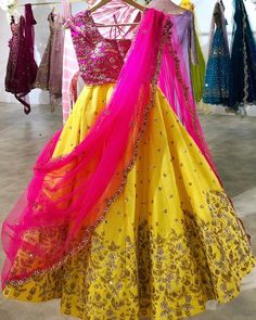 Beautiful yellow color lehenga and pink color blouse with net dupatta. Lehenga and blouse with hand embroidery work. Blouse Lehenga, Half Saree Lehenga, Lehnga Dress, Bridal Lehenga Choli, Lehenga Skirt, Wedding Lehnga, Yellow Lehenga, Red Lehenga, Indian Lehenga