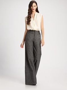 Go 70s glam with a wide flare pant - but keep your top lean with a close-fitting blouse or blazer    Derek Lam  Flared Trousers  $550  Saks