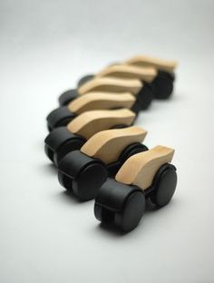 Toy cars made from recycled chair casters, discarded plastics, and scrap wood.