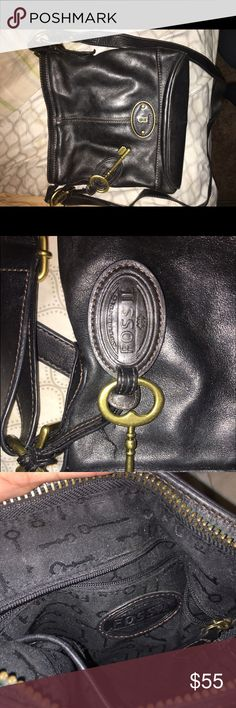 Fossil cross body purse Black fossil purse , with a gold key. Super cute and still in excellent condition . reasonable offers accepted . Fossil Bags Shoulder Bags