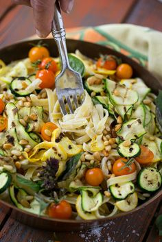 This zucchini fettuccine alfredo features a healthier remake of the classic sauce (no cream!) with the addition of grilled zucchini, cherry tomatoes and pine nuts.