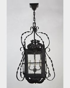 A darkened wrought iron, pierced-work lantern with seeded glass panels. From the Tallman Tudor estate in Nyack, NY.
