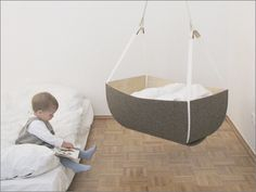 Another hanging baby cot, only you can make this one at home. I think this is one of the neatest ideas