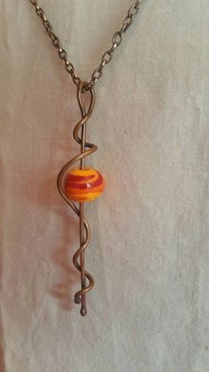 I like the setting -- Orange Lampwork Bead Wire Jewelry Designs, Jewelry Crafts, Jewelry Art, Beaded Jewelry, Jewelry Shop, Jewelry Making, Jewellery, Fashion Jewelry, Unique Jewelry