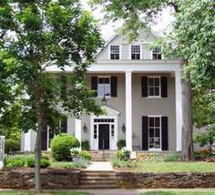 Grey house with black shutters and white trim